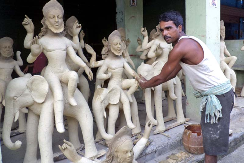A sculptor displays his sculptures he made for the upcoming Bishwokarma Puja, in Topa of Saptari district, on Tuesday, September 13, 2016. Photo: RSS