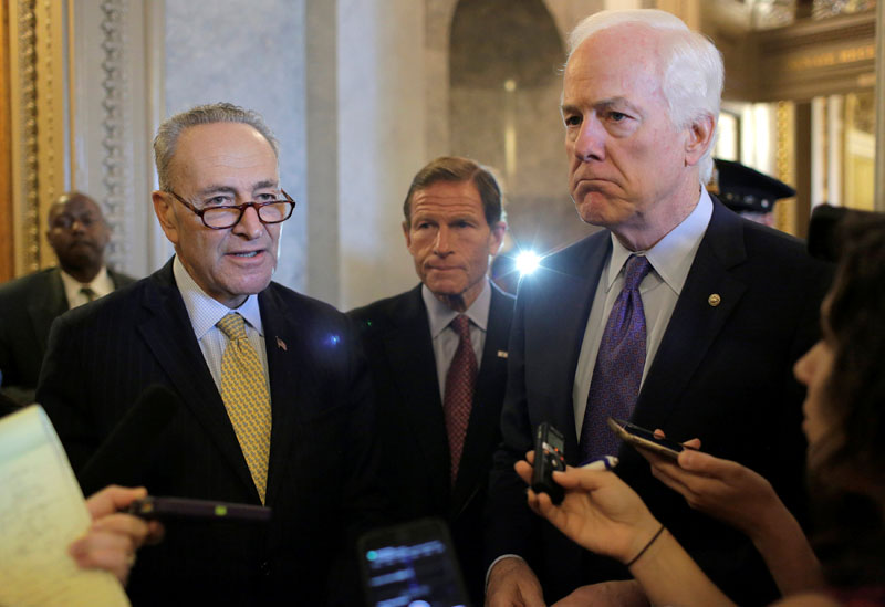 Senators Chuck Schumer (left), Richard Blumenthal, and John Cornyn, speak after the Senate voted to override US President Barack Obama's veto of a bill that would allow lawsuits against Saudi Arabia's government over the September 11 attacks, on Capitol Hill in Washington, US, on September 28, 2016. Photo: Reuters