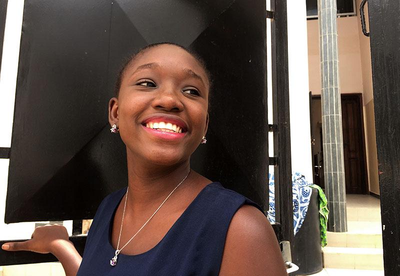 In this photo taken on Wednesday, Sept. 7, 2016, design engineering graduate Youma Fall smiles outside her PayDunya office in Dakar, Senegal. Photo: AP