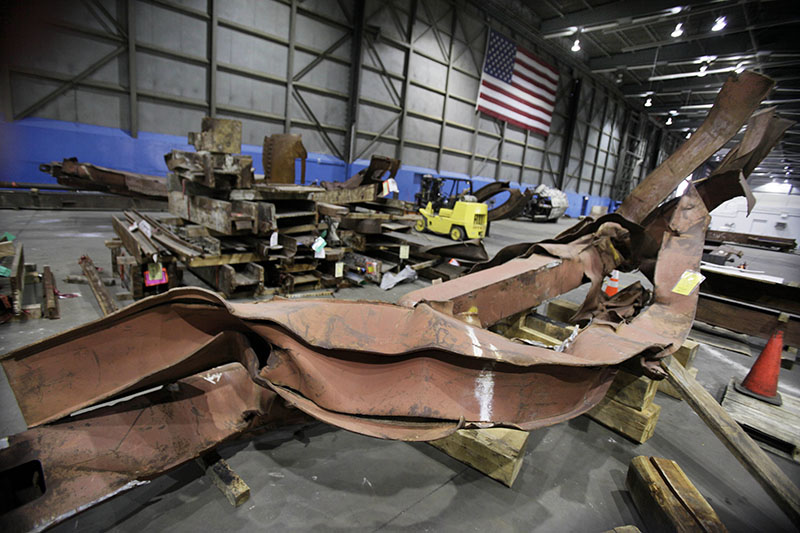 FILE - Twisted beams and other remains from the attacks at the World Trade Center sit in Hangar 17 at New York's John F Kennedy International Airport, on Wednesday, March 23, 2011. Photo: AP