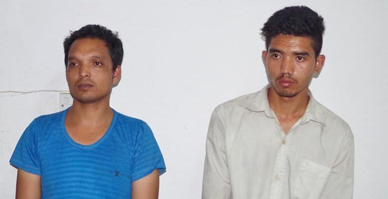Shankar Lakhe and Chandra Bahadur Tamang being paraded at the Metropolitan Police Office in Ranipokhari. Photo: MPO/Nepal Police