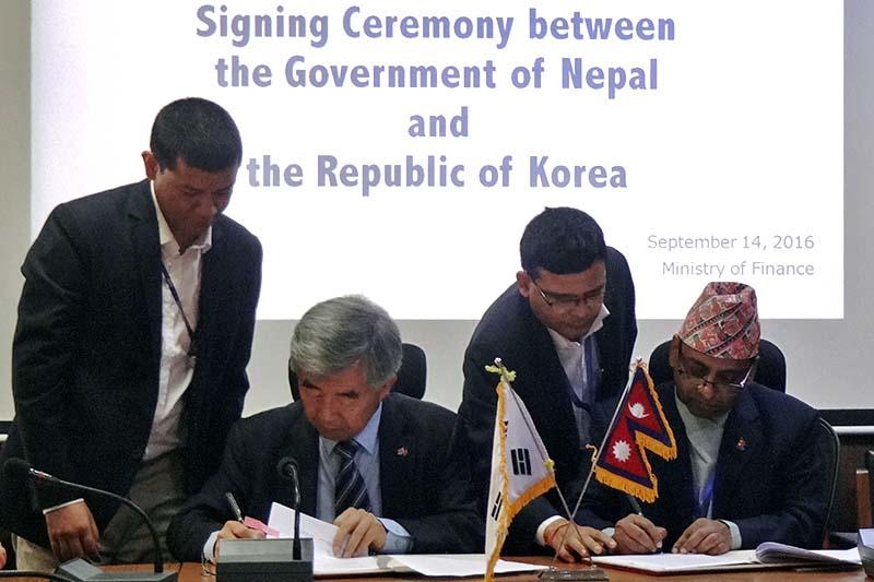 Secretary at the Ministry of Finance Shantaraj Subedi (right) and Korean Ambassador to Nepal Yong-Jin Choe sign a memorandum of understanding amid a programme in Kathmandu, on Wednesday, September 14, 2016. Photo Courtesy: KOICA-Nepal