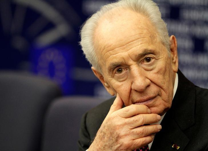 Former Israeli president Shimon Peres attends  a press conference at the European Parliament in Strasbourg, in this March 12, 2013 file photo. REUTERS/Jean-Marc Loos/Files