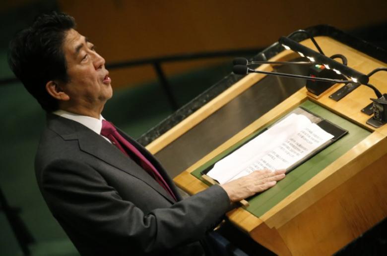 Japanese Prime Minister Shinzo Abe addresses the 71st United Nations General Assembly in Manhattan, New York, U.S. September 21, 2016. REUTERS/Carlo Allegri