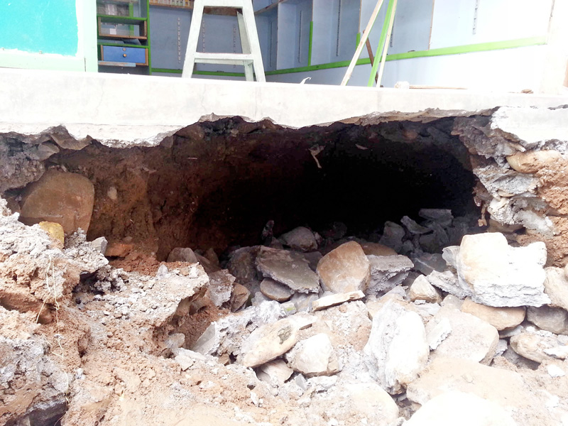 A sinkhole formed on a road is seen extending below the foundation of a house in Gairapatan of Pokhara, on Sunday, September 4, 2016. Photo: Rup Narayan Dhakal