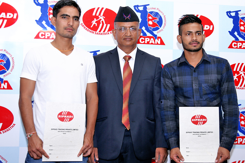 U-19 cricketers Arif Sheikh (left) and Sunil Dhamala pose for a photo after being sponsored by Sipradi Trading Pvt. Ltd for two years, in Kathmandu, on Wednesday, September 7, 2016. Photo: RSS