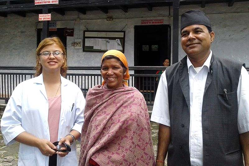 (Centre) Sita Pariyar (45) smiles after regaining her eyesight three years in Dang district, on Monday, September 12, 2016. She had lost her eyesight to cataract three years ago. Photo: RSS