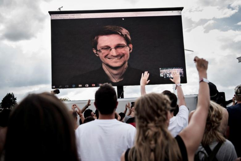 American whistleblower Edward Snowden is seen on a screen as he delivers a speech during the Roskilde Festival in Roskilde, Denmark, June 28 2016. Scanpix Denmark/Mathias Loevgreen Bojesen /via REUTERS