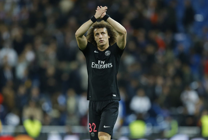 FILE -  PSG's David Luiz waves to his team's supporters after the Champions League group A soccer match between Real Madrid and PSG at the Santiago Bernabeu stadium in Madrid, on Tuesday, November 3, 2015. Photo: AP