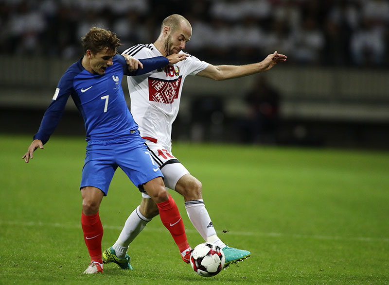 France's Antoine Griezmann (left) challenges for the ball with Belarus' Ivan Maevski during their World Cup Group A qualifying match between France and Belarus at the Borisov-Arena stadium in Borisov, Belarus, on Tuesday, September 6, 2016. Photo: AP