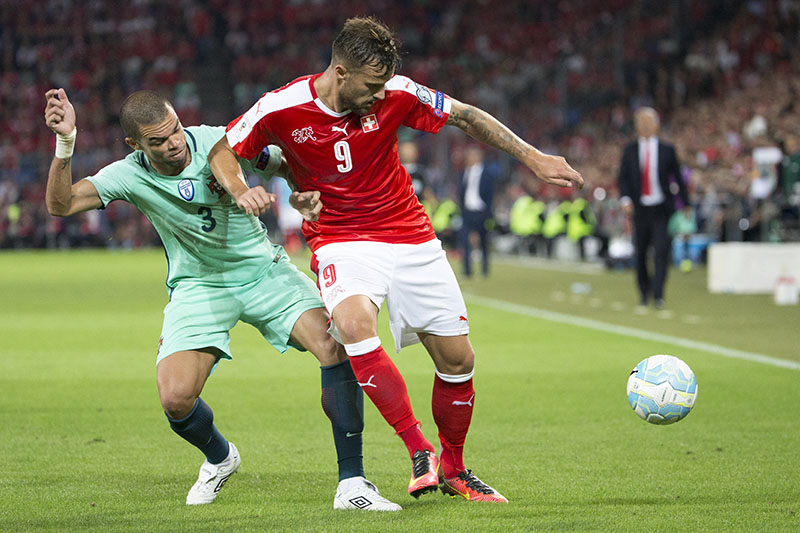 Portugal's Pepe (left) battles for the ball with Switzerland's Haris Seferovic during the 2018 World Cup Russia group B qualification soccer match between Switzerland and Portugal at the St. Jakob-Park stadium in Basel, Switzerland, on Tuesday September 6, 2016. Photo: Salvatore Di Nolfi/Keystone via AP