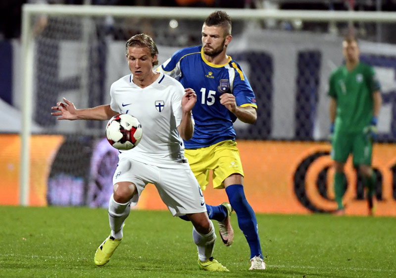Eero Markkanen of Finland (left) and Vedat Muriqi of Kosovo vie for the ball during the 2018 World Cup Group I qualifying soccer match Finland against Kosovo in Turku, Finland, on Monday September 5, 2016. Photo: Jussi Nukari/Lehtikuva via AP