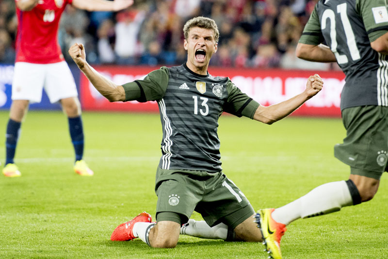 Germany's Thomas Muller celebrates after scoring his side's third goal of the game against Norway during their World Cup Group C qualifying soccer match in Oslo, on Sunday, September 4, 2016. Photo: Jon Olav Nesvold/NTB Scanpix via AP