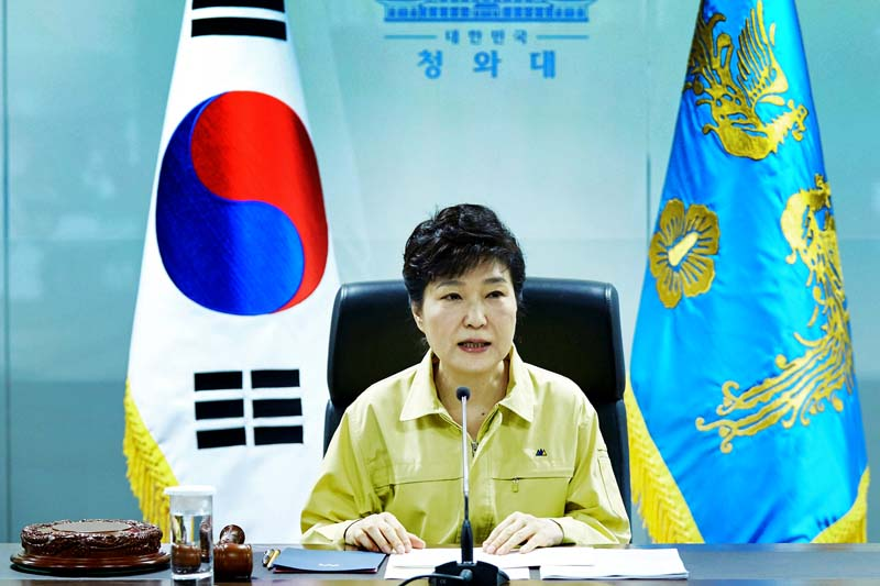 South Korean President Park Geun-hye presides over a National Security Council meeting at the Presidential Blue House in Seoul, on August 22, 2016. Photo: The Presidential Blue House via Reuters