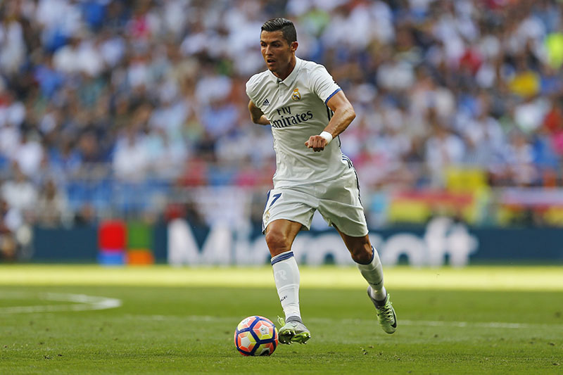 Real Madrid's Cristiano Ronaldo runs with the ball during the Spanish La Liga soccer match between Real Madrid and Osasuna at the Santiago Bernabeu stadium in Madrid, on Saturday, September 10, 2016. Ronaldo scored once in Real Madrid's 5-2 victory. Photo: AP