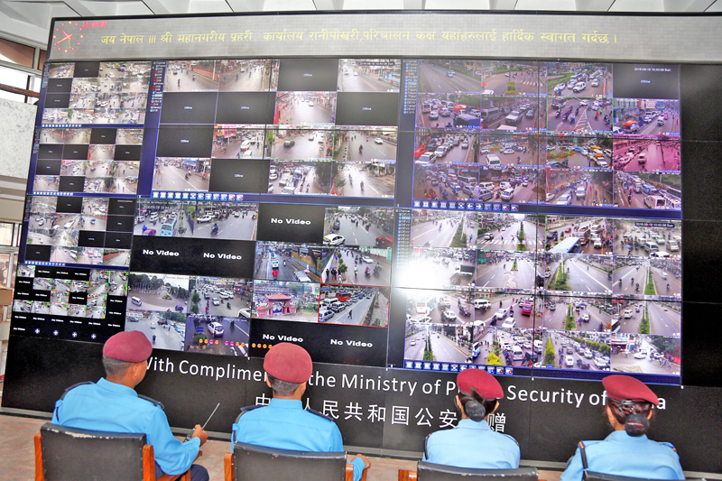 Traffic police personnel observing traffic movements of Kathmandu Valley on a large screen, at the Metropolitan Police Office, Ranipokhari, after CCTV cameras were installed in various points in the Valley, on Sunday, September 18, 2016. Photo: RSS