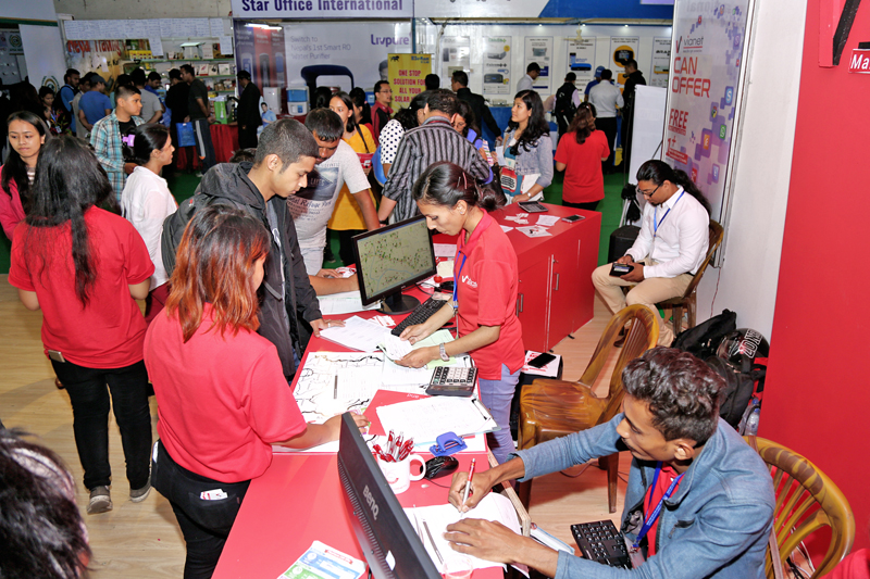 People throng a stall at the Subisu Can CommTech 2016,in Bhrikutimandap, Kathmandu, on Sunday, September 11, 2016. Photo: RSS