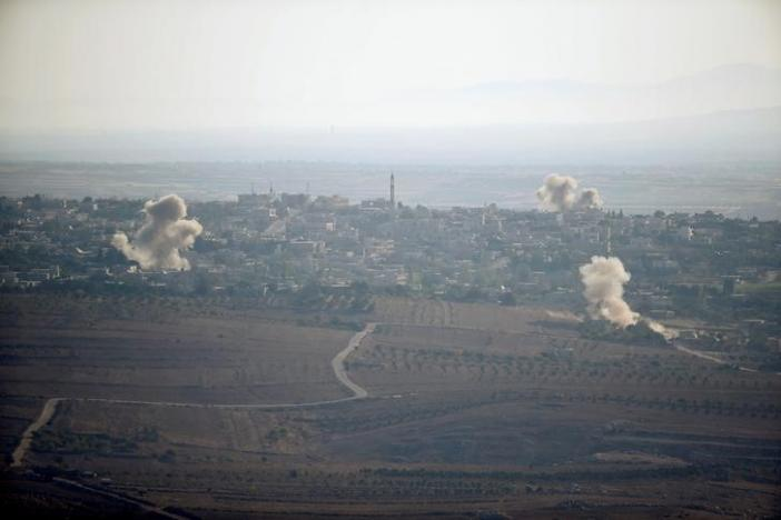 Smoke from explosions rises during fighting in the village of Jubata Al Khashab in Syria, as seen from the Israeli side of the border fence between Syria and the Israeli-occupied Golan Heights September 11, 2016. REUTERS/Baz Ratner