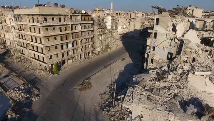 A still image taken on September 27, 2016 from a drone footage obtained by Reuters shows damaged buildings in a rebel-held area of Aleppo, Syria. Handout via Reuters