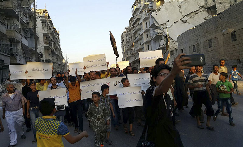 FILE -  Activists in Syria's besieged Aleppo protest against the United Nations for what they say is its failure to lift the siege off their rebel-held area, in Aleppo, Syria, on September 13, 2016. Photo: Modar Shekho via AP