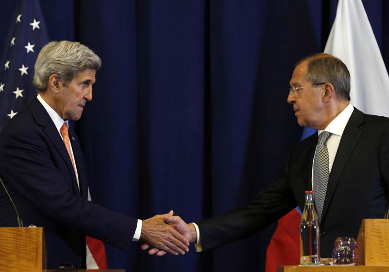 File- Secretary of State John Kerry (L) and Russian Foreign Minister Sergei Lavrov shakes hands at the conclusion of a news conference following their meeting to discuss the crisis in Syria, in Geneva, Switzerland, on September 9, 2016. Photo: AP