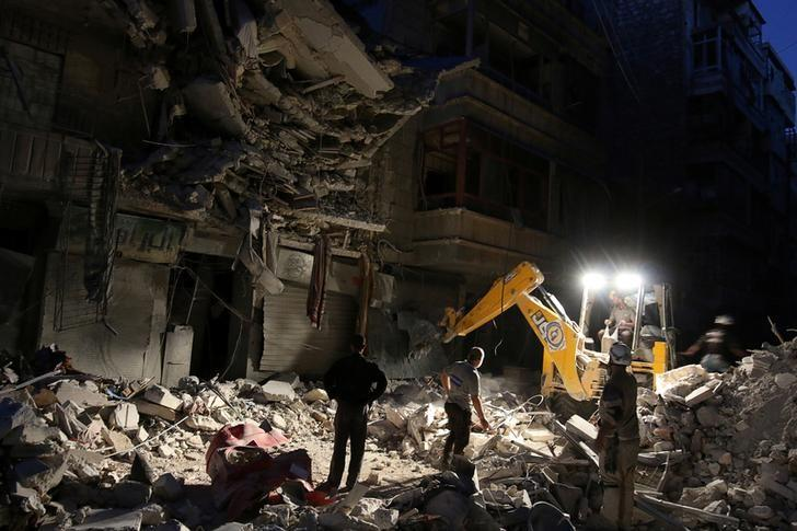 Civil Defense members search for survivors at a site hit by an airstrike in the rebel-held al-Shaar neighbourhood of Aleppo, Syria, September 27, 2016. REUTERS/Abdalrhman Ismail