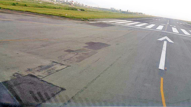Cracks and potholes can be seen on Tribhuvan International Airport runway, raising safety concerns, on Thursday, September 15, 2016. Photo: THT file