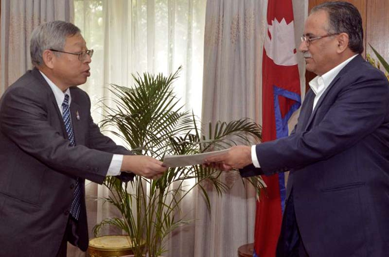 Thailand's Ambassador to Nepal Vutti Vuttisant (left) hands over an invitation to Prime Minister Pushpa Kamal Dahal to attend the second Asia Cooperation Dialogue (ACD) Summit in Thailand, at the latteru0092s official residence in Baluwatar, on Monday, September 5, 2016. Photo Courtesy: PMu0092s Secretariat