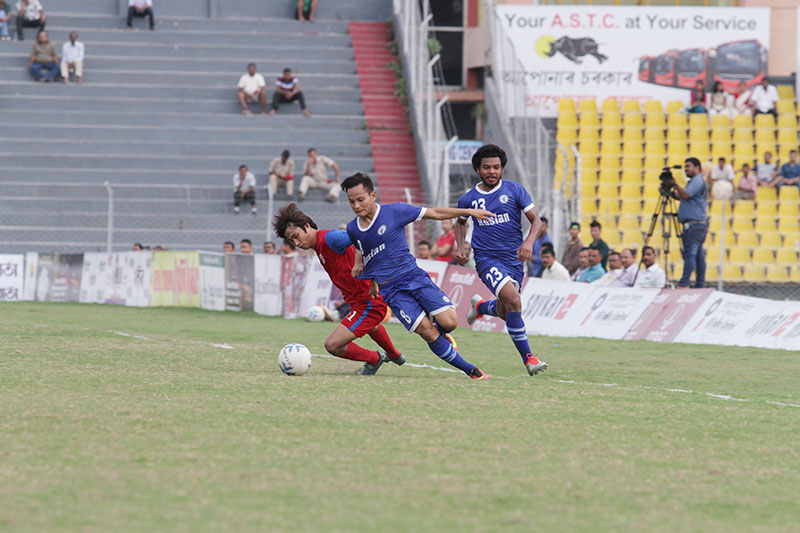 A player of Sikkim United Club vies with Three Star Club opponents during their 64th Bharat Ratna Lokopriya Gopinath Bordoloi Trophy Football Tournament match in Guwahati on Wednesday, September 28, 2016. GoalNepal