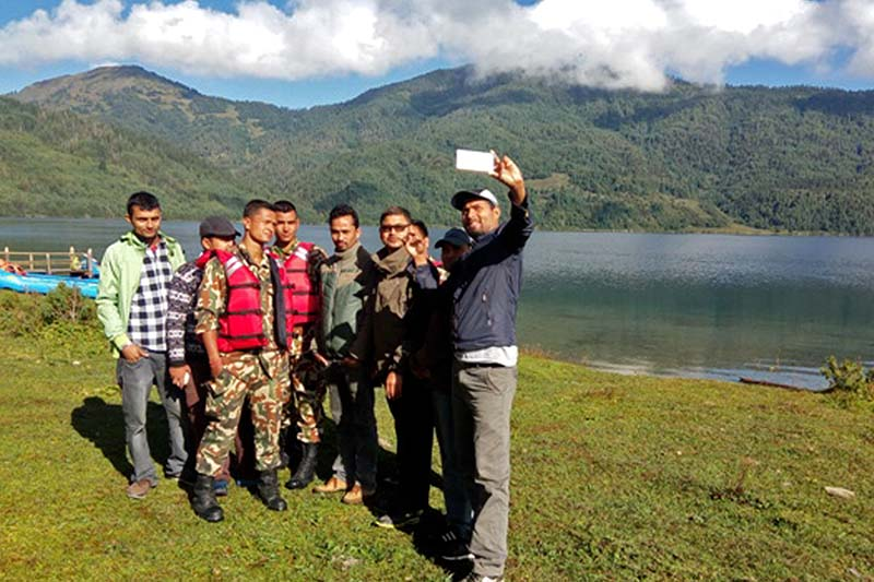 Domestic tourists busy taking a selfie near the Rara Lake, the biggest and deepest fresh water lake in Nepal, on Sunday, September 25, 2016. Photo: RSS