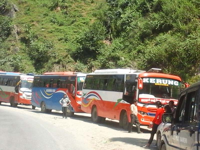 The buses which left Kathmandu for Nuwakot and Rasuwa get stopped in Galchhi of Dhading as transporters in the two districts obstructed the road, on Friday, September 30, 2016. Photo: Keshav Adhikari