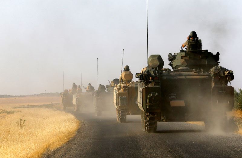 File - Turkish armoured personnel carriers are driven towards the border in Karkamis on the Turkish-Syrian border in the southeastern Gaziantep province, Turkey, on August 27, 2016. Photo: Reuters