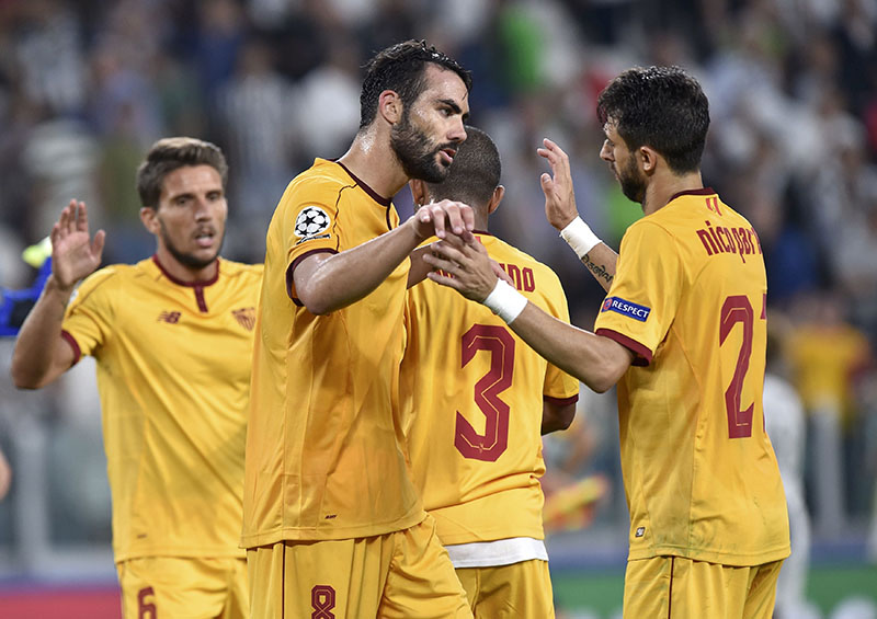 Sevilla's Vicente Iborra reacts with team mates at the end of the UEFA Champions League Group Stage - Group H match against Juventus at Juventus Stadium on Wednesday, September 14, 2016. Photo: Reuters