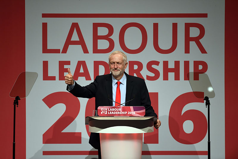 Jeremy Corbyn celebrates his victory following the announcement of the winner in the Labour leadership contest between him and Owen Smith at the ACC Liverpool, England, on Saturday, September, 24, 2016. Photo: Danny Lawson/PA via AP