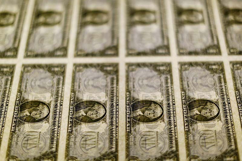 United States one dollar bills are seen on a light table at the Bureau of Engraving and Printing in Washington on November 14, 2014. Photo: Reuters