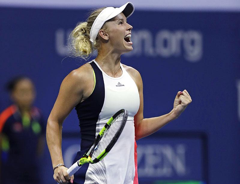Caroline Wozniacki, of Denmark, pumps her fist after defeating Anastasija Sevastova, of Latvia, 6-0, 6-2 during a quarterfinal at the US Open tennis tournament, Tuesday, Sept. 6, 2016, in New York. Photo: AP
