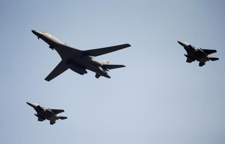 A U.S. Air Force B-1B bomber flies over Osan Air Base in Pyeongtaek, South Korea, September 13, 2016.  REUTERS/Kim Hong-Ji/Files