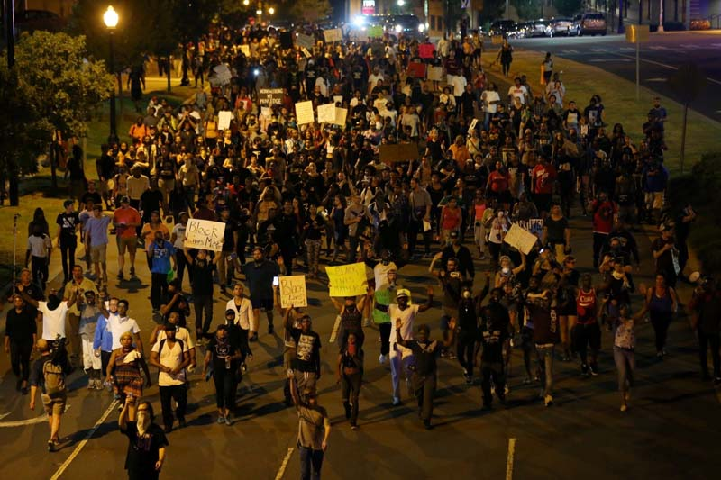 Demonstrators march outside the downtown streets protesting the police shooting of Keith Scott in Charlotte, North Carolina, US, on Saturday, September 24, 2016. Photo: Reuters