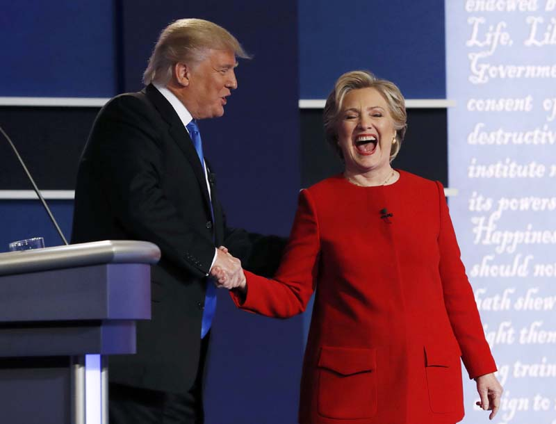 Republican US presidential nominee Donald Trump greets Democratic US presidential nominee Hillary Clinton after their first presidential debate at Hofstra University in Hempstead, New York, US, on Monday, September 26, 2016. Photo: Reuters