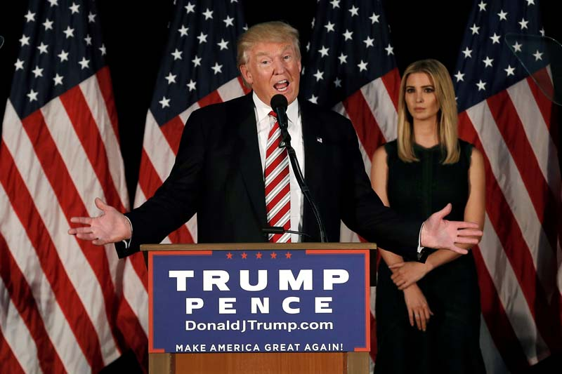 File- Republican presidential nominee Donald Trump speaks at a campaign event as his daughter Ivanka looks on in Aston, Pennsylvania, US, on Tuesday, September 13, 2016. Photo: Reuters