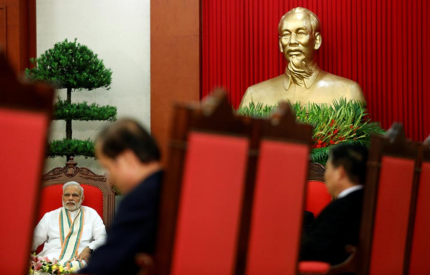 India's Prime Minister Narendra Modi (L) sits under a statue of Vietnamese revolutionary leader Ho Chi Minh during a talk with Vietnam's Communist Party General Secretary Nguyen Phu Trong (unseen) at the Party's headquarters in Hanoi, Vietnam September 3, 2016. REUTERS/Kham