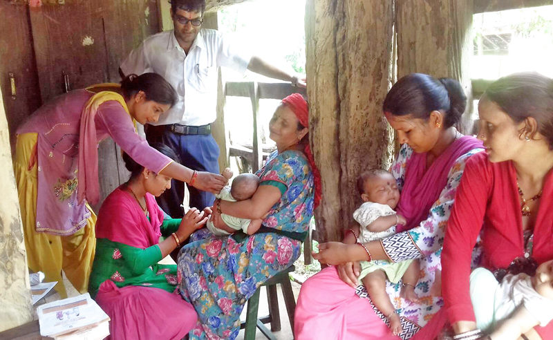 Mothers visiting a nearby health post to vaccinate their children in Kanchanpur district, on Friday, September 23, 2016. Photo: RSS