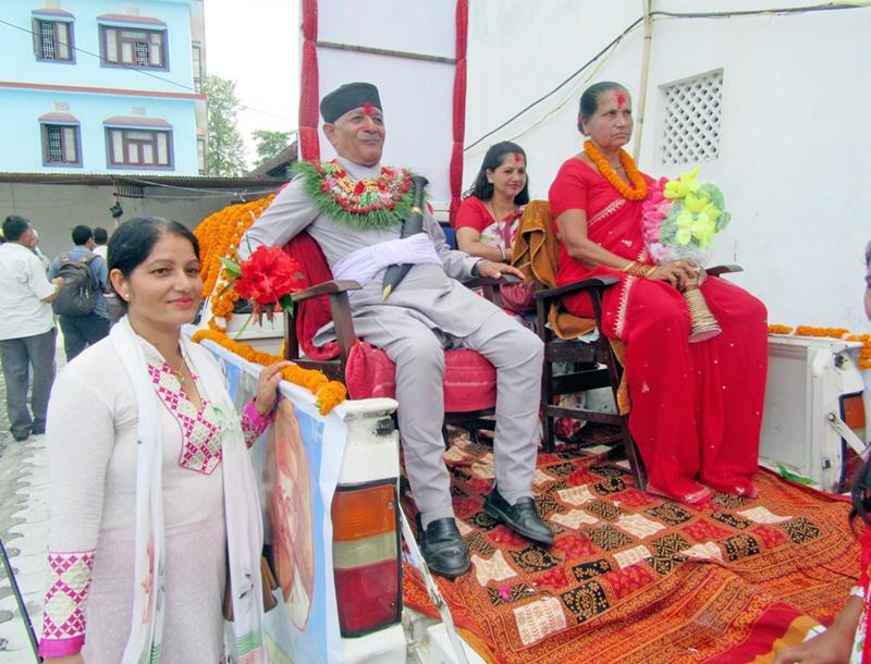Professor Dr. Tanka Prasad Neupane along with his wife being honoured in Itahari, of Sundari district, on Thursday, Septermber 1, 2016. Photo: RSS