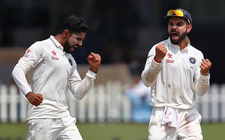 Cricket - India v New Zealand - First Test cricket match - Green Park Stadium, Kanpur, India - 24/09/2016. India's Ravindra Jadeja (L) celebrates with Virat Kohli after taking the wicket of New Zealand's Luke Ronchi. REUTERS/Danish Siddiqui