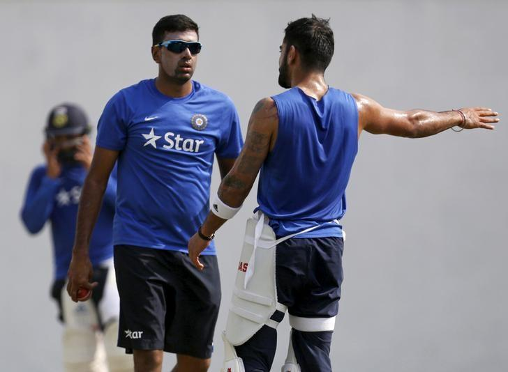 India's captain Virat Kohli (R) speaks with his teammate Ravichandran Ashwin during a practice session in Nagpur, India, November 24, 2015.  REUTERS/Amit Dave/Files