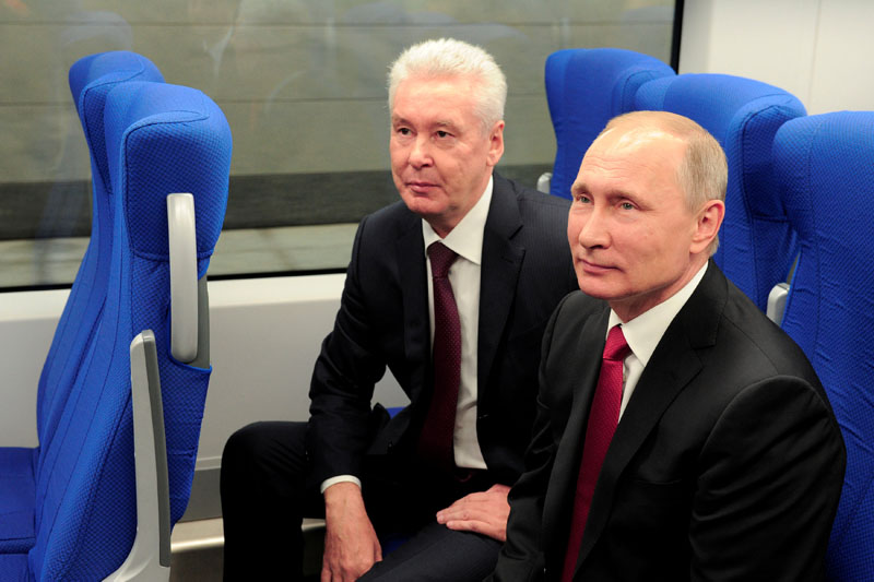 Russian President Vladimir Putin (Right) and Moscow Mayor Sergei Sobyanin sit in a railway coach as they attend the opening of the Central Ring line in Moscow, Russia, on September 10, 2016. Photo: Sputnik via Reuters