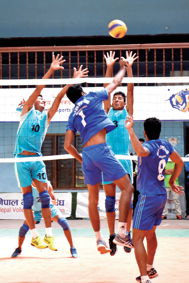Players of Nepal APF Club and Help Nepal Sports Club (front) in action during their NVA National Club Volleyball Championship match in Kathmandu on Sunday.