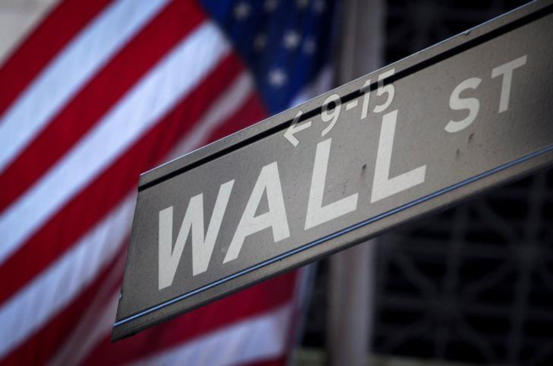 File - A Wall Street sign is pictured outside the New York Stock Exchange in New York, on October 28, 2013. Photo: Reuters