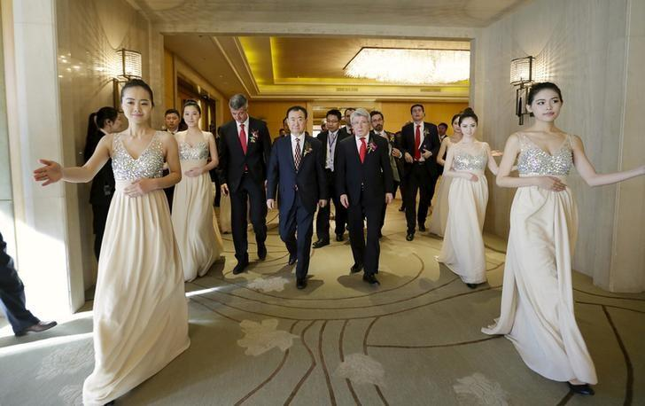 Wang Jianlin (front C), chairman of Dalian Wanda Group arrives for a signing ceremony in Beijing, January 21, 2015. REUTERS/Jason Lee/Files