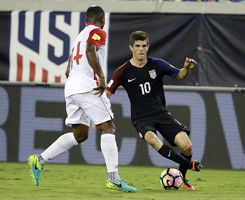 United States' Christian Pulisic (10) tries to moves the ball around Trinidad & Tobago's Andre Boucaud (14) during the first half of a CONCACAF World Cup qualifying soccer match, on Tuesday, September 6, 2016, in Jacksonville, Florida. Photo: AP